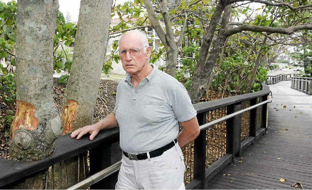 DAMAGE DONE: Coolum Boardwalk Association president Dave Simons inspects the tree vandalism.
