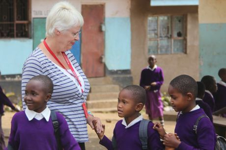 Jill Borsh visits with children at a government run school in Tanzania.