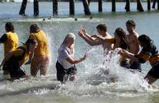 Bribie Island High School students celebrate the end of their school years with a splash in the water at Sylvan Beach.