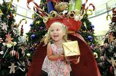 Ella Knudsen,3, playing on Santa's chair at Grand Central Shopping Centre.