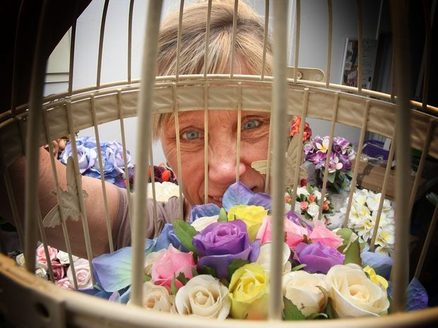 Mandy McShae with one of her flower arrangements. Photo: Blainey Woodham / Daily News