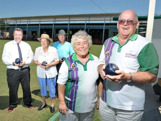 Goodna Bowls Club secretary and treasurer Cath Wilmington and chairman Mal Levarre - Waters with club members (at back) are helping the club get back on it's feet after the flood of 2011.