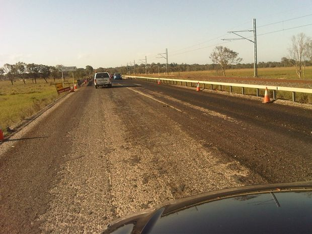 Bitumen 'lifted up' south of Yeppen roundabout on the Bruce Highway. Photo: Department of Main Roads