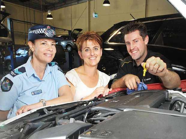 UNDER THE HOOD: Senior Constable Kerrin Sheedy, motorist Sophie Dowe and mechanic Matt Crook run through some basic car maintenance tips ahead of the program to be held at Ian Boettcher Mazda.