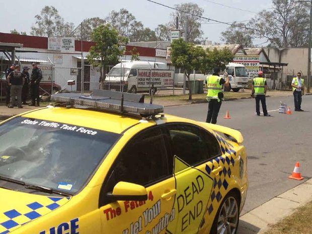 TESTING TIMES: Police conduct breath and drug tests on Nomads in Goodna last month.