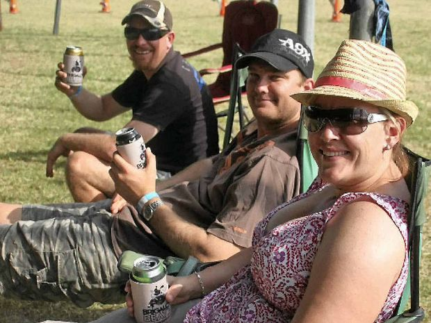 BEATZ SEATS: Nathan Harch, Glen Stephenson and Katrina Boardman, all of Biloela, take a relaxed approach to the festival on the Sunday.