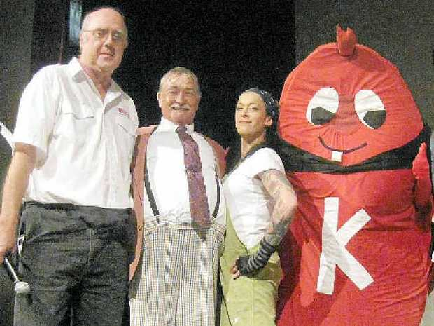 THANKS: Kidney Support Network's Reg Brine, left, and mascot Mr K accept the money from Coolum Theatre Players.