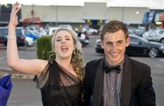 Kate Burrows and Anthony Watts celebrating at the St Ursula's College formal.