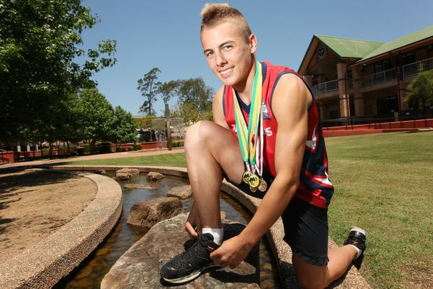 Trae Williams, 15 broke a 26-year-old Met West Record in winning the 100m track and field at St John's Anglican College. Photo: Inga Williams / The Satellite