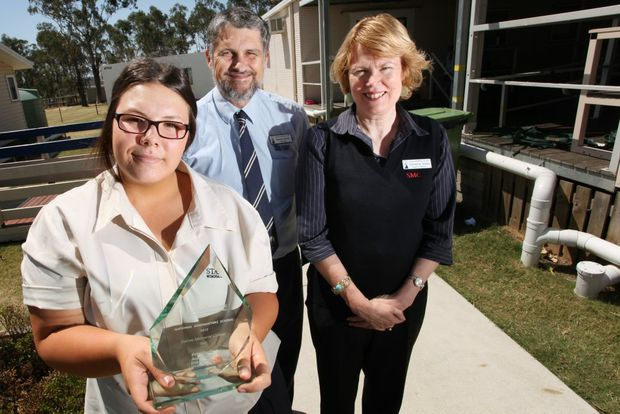 Staines Memorial College has been recognised for their work in promoting mental health at the MindMatters Recognition event in Canberra. Pictured is student Alyssa Edwards, principal Norton Sands and head of welfare Christine Teepa. Photo: Inga Williams / The Satellite
