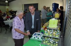 100 YEARS IN A FLASH: The oldest teacher, Mrs Pearl Walters (Miss Cummins) and principal Matt Vine cutting the cake at the St Patrick's celebrations.
