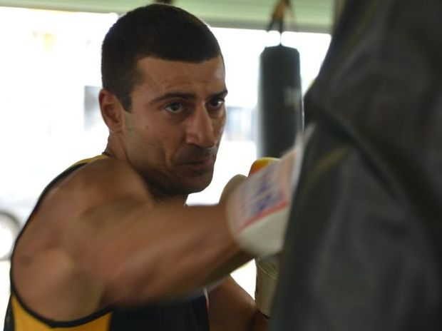 Boxer John Peros, in a 2012 Daily Mercury photo as he trained ahead of national titles, has been arrested for the murder of Shandee Blackburn.