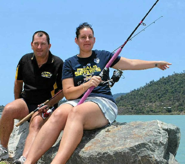 Whitsunday residents Pete Collingwood and Suzanne Crabtree have seen a crocodile at Boathaven Bay on two separate occasions, one of which involved accidentally hooking the reptile on the end of their fishing line.