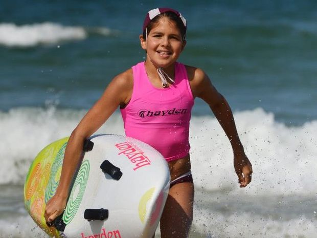 Eleven-year-old Tamarind Wildin-Snedden turned back from the opportunity to win her first iron man race to rescue a fellow competitor. Photo: Iain Curry/ Sunshine Coast Daily