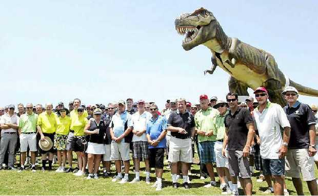 PREHISTORIC SPECTATOR: Golfers at the annual Sunshine Coast Sports Federation golf day meet their new caddy.
