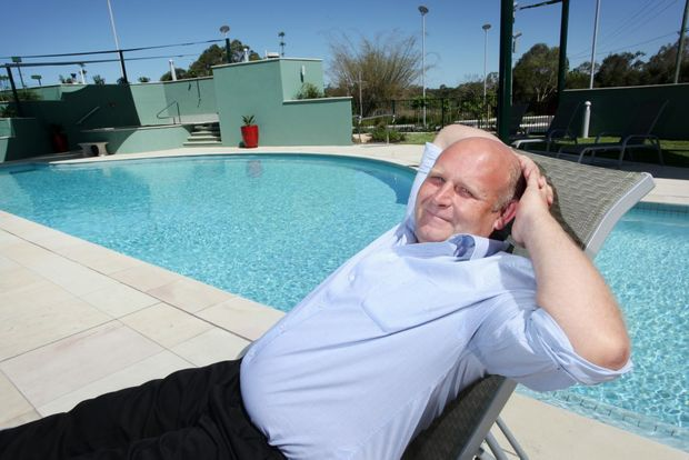 Manager Greg O'Leary relaxing poolside at the McNevins Motel which will be undergoing a makeover and unveiling as the new five-star Ferrymans Hotel. Photo: Inga Williams / The Reporter