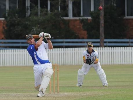Matt Nowitzke smashes a boundary in Past Grammars' victory over Bushrangers on Saturday.