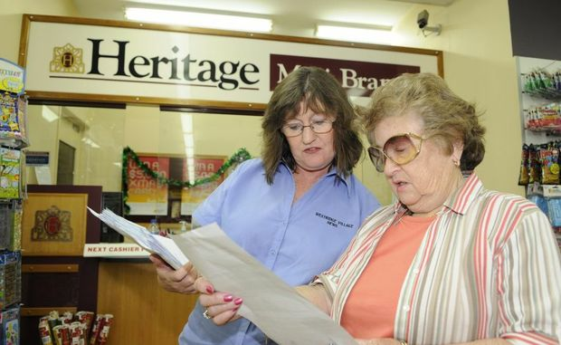 Westridge Village news owner Suzanne Morgan discusses the closure of the mini-branch with customer Dellys Kelly.