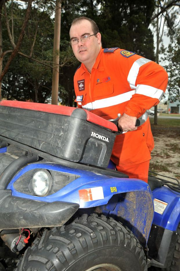 Kris Conroy shows off his quad bike skills having been presented with an award for outstanding leadership and commitment to Bribie SES. Photo:Iain Curry / Sunshine Coast Daily