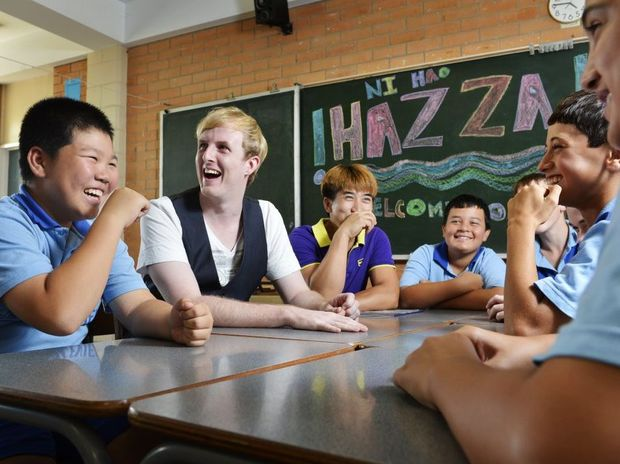 "Chinese pop sensation Harry Harding ""Hazza"" shares a joke with Raceview State School students including Michael Chen (left) and Michael's father, who recently migrated from China."