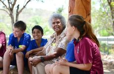 Indigenous elder Jacqueline Johnson talks with students at the official opening ceremony of the Yarning Circle at Toolooa State High School, Gladstone.