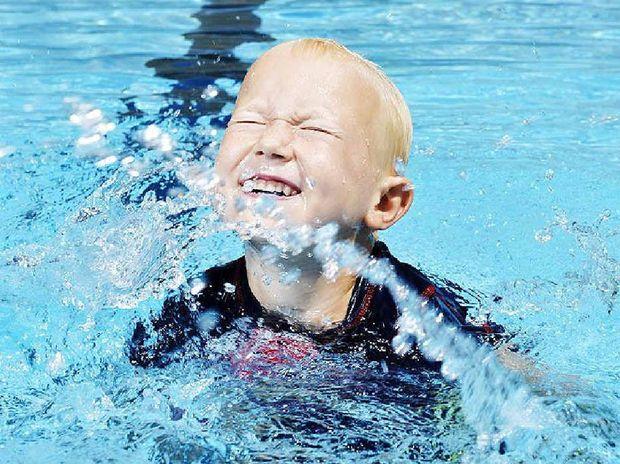 IT'S COOL: Swedish visitor Fredrik Stromblad, 5, cools down at Bundamba Swim Centre.