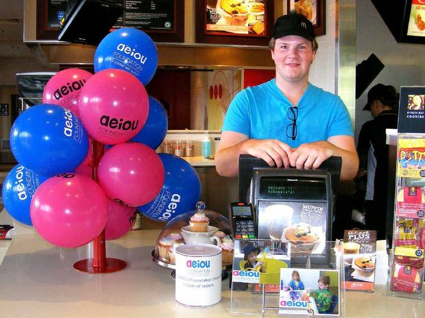 GOT THE BLUES: McDonald's staff, including Zachary Turner, turned blue for AEIOU.