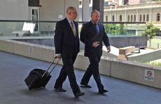Lawyers Michael Bosscher and Tim Meehan, acting for accused man Brett Peter Cowan, leave Brisbane Magistrates Court during the Daniel Morcombe murder committal hearing.