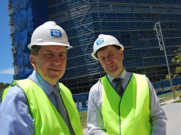 Minister for Tertiary Education Chris Evans with SCU vice chancellor Peter Lee at the Gold Coast campus' new building. Photo: Mairi Manley.