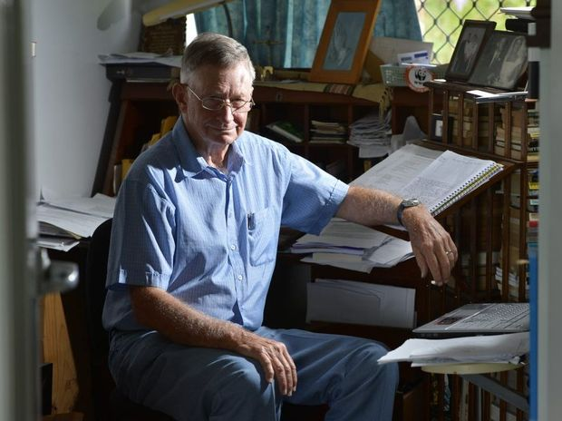 Noel Davis at work in his home study. Noel has written a book about his engineer grandfather Walter Taylor.