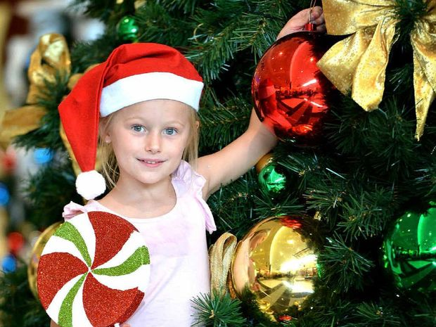 Five-year-old Tyrah Hale joins in the Christmas spirit at Centro.