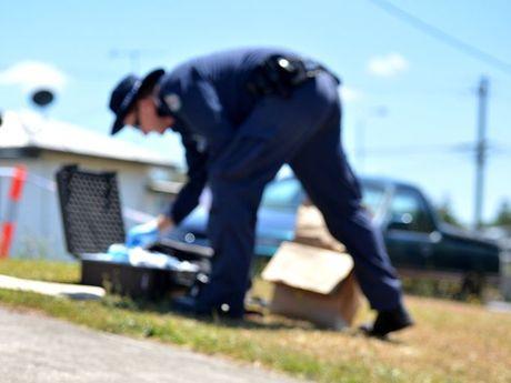 Police investigating a disturbance in Oak Street.