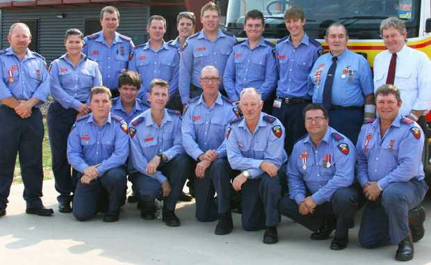 Gregory MP Vaughan Johnson poses with firefighters outside the new $4m Emerald station.