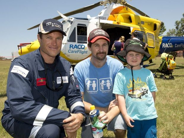 (from left) CareFlight pilot Hamish Felton-Taylor with Anthony powderly and son Cristian. RACQ Careflight hangar opening. Photo Nev Madsen / The Chronicle