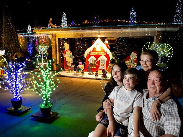 Cody and Demi Mutch with their grandparents Sylvia and Sante Andreatta at their festively decorated Box St home.