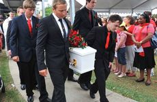 Pallbearers Matt Hannah (from left) and Scott Balkin (front right), Josh Hannah (second row left) and Tom Palmer (second row right) and Daniel's brothers Bradley and Dean (at rear obscured) carry Daniel to his final resting place.