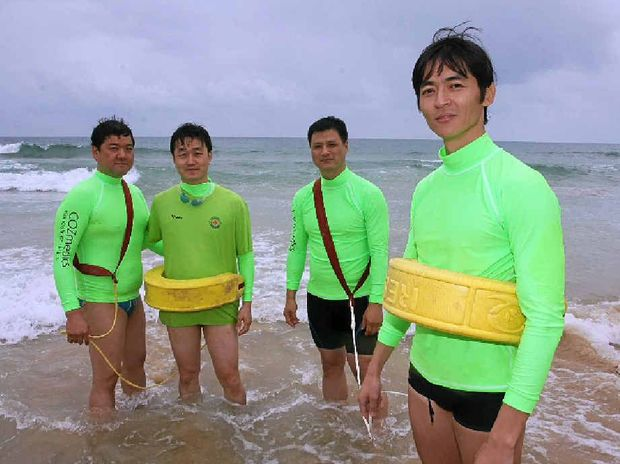Lee Jong Deock, Jeong Hui-Joo, Jeon Jong and Park Choul-Woo were part of the South Korean contingent learning surf rescue skills at Mooloolaba beach.
