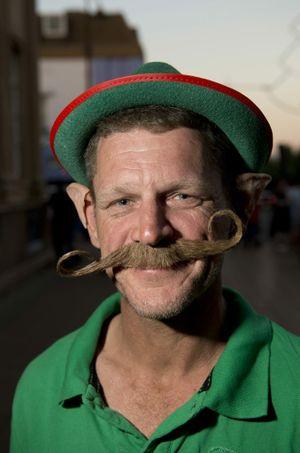 Patrick Heylen gets in the spirit as one of Santa&squot;s little helpers.