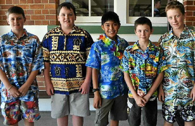 St Mary's students Thomas Burke, Dylan Lambert, Ian Ducao, Drewe McConville and Jack O'Dea decked out in their Hawaiian shirts to support their teacher Catherine Lutvey.