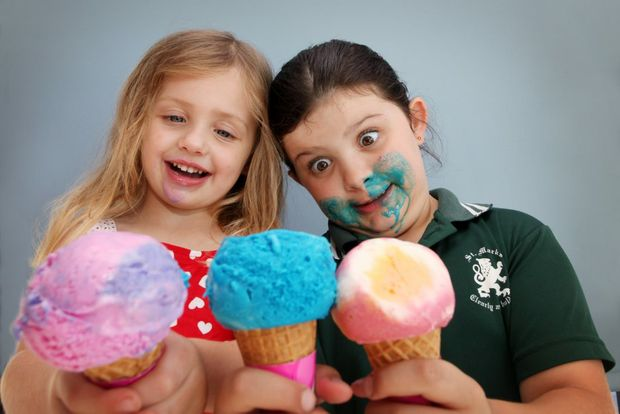Georgia, 4 and Maddison Smith, 8 enjoying ice cream at Baskin and Robbins, Mt Ommaney. Photo: Inga Williams / The Satellite