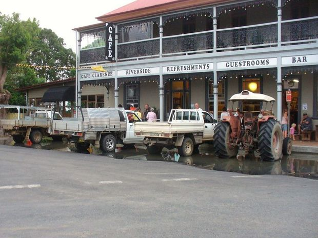 THE Commercial Hotel in Ulmarra where our writer, Nick Inmon, spent (or misspent) many Christmases in his younger days. In this photo the tractor was used to get through flood water to get to those vital bar treats.