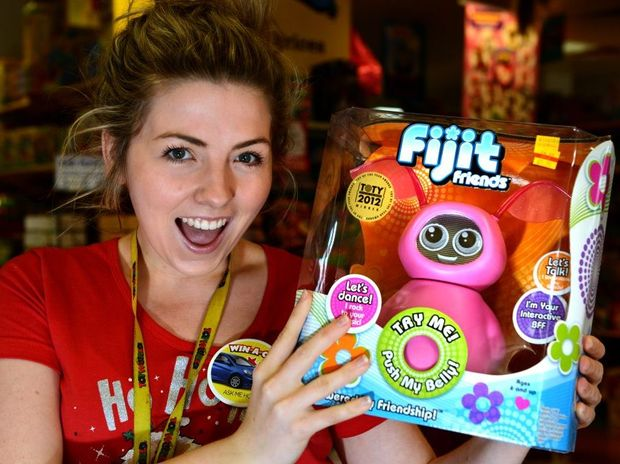 Megan Atwood with a new toy from ToyWorld, Fijit Friends. Photo: John Gass / Daily News
