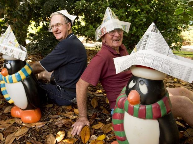 Geoff Deacon (left) and Rod Hultgren will be ready to go when a world record for most people wearing hats made from newspaper hits the Lions Christmas Wonderland.