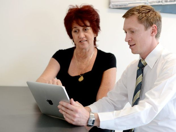 Julie Wood and Andrew Allen using technology to sell houses. Ray White, Gladstone.