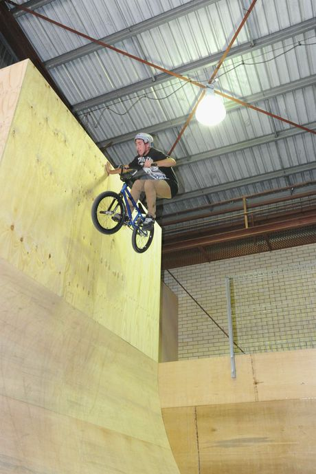 Rock Off Indoor Park opening - Ben Hindmarsh performs a hand plant 5.4 metres up the vert wall. Photo: Alistair Brightman / Fraser Coast Chronicle