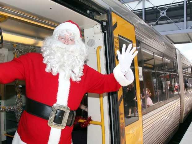 Santa arriving on the Santa Express at Richlands Station. Photo: Inga Williams / The Satellite