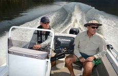 Gympie's Chris Mangold and Tewantin's Don Robertson head up Borumba Dam to release fish.