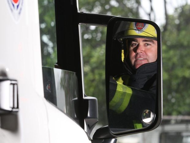 Senior firefighter Jason Recliner checking his mirrors. Photo Blainey Woodham / Daily News