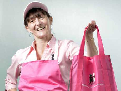 CARING SMILE: McGrath Foundation breast care Nurse Karen Miles with fundraising items.