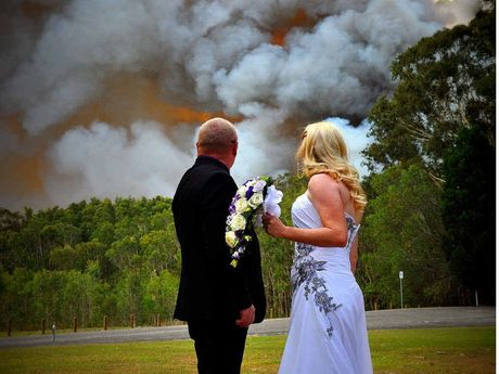 Martin McKendrick and Laura Williams are wed with the raging fire nearby.